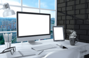 IT Services, office workspace with white desk monitor ipad mobile